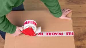 fragile tape over a box